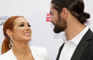 Becky Lynch smiles to seth Rollins