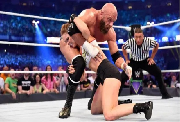 Triple H and Ronda Rousey WWE