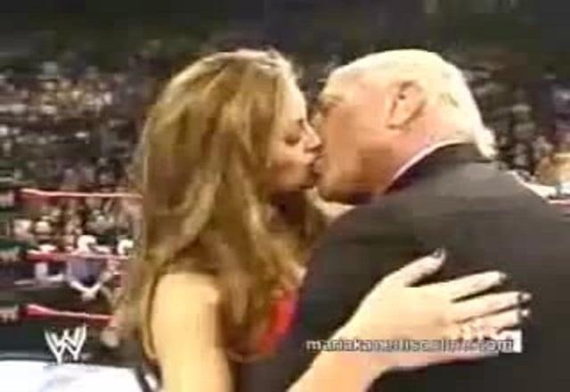 Ric Flair kissing Maria Kannelis